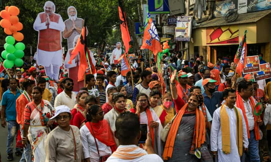 Supporters of India's ruling Bharatiya Janata party (BJP) take part in a mass election rally in Kolkata, India, in early April.