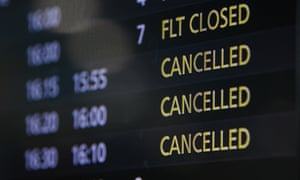 A flight information board showing several cancelled flights at Sydney domestic airport on Friday. On Sunday the prime minister said all 'non-essential' holiday plans – international and interstate – should be postponed.