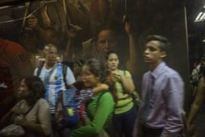 Commuters wait to board a crowded subway car in Caracas, Venezuela.