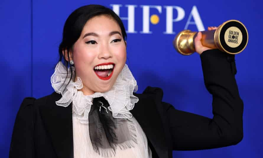 Awkwafina with the best musical or comedy actress Golden Globe.