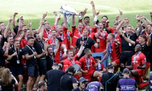 Vincent Koch and Liam Williams of Saracens lift the trophy as the celebrations continue.