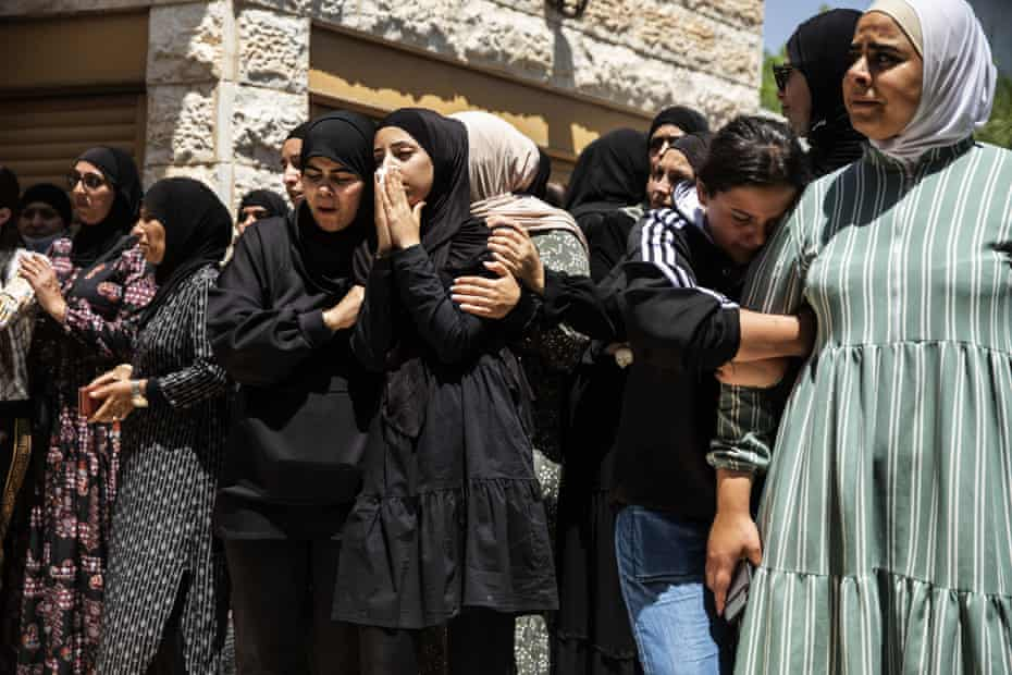 Mourners react during the funeral of Israeli Arab Khalil Awaad and his daughter Nadine, 16, in the village of Dahmash near the Israeli city of Lod, after a rocket fired from Gaza Strip hit their house and killed both father and his daughter.