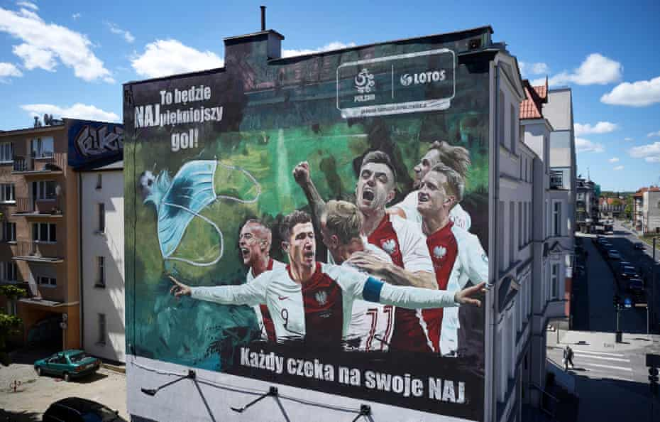 A huge mural on an apartment block in Gdansk, created to raise funds for Covid-19 research.