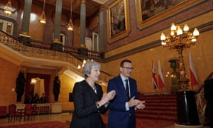 Poland's prime minister Mateusz Morawiecki and Theresa May applaud after hearing a choir sing during the UK-Poland Inter-Governmental Consultations at Lancaster House in London earlier today.
