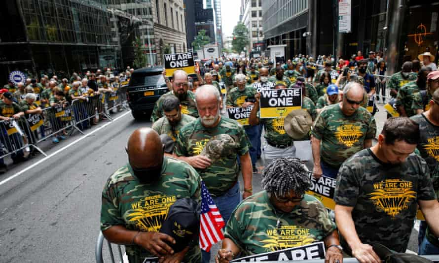 Members of UMWA and other labor leaders picket outside BlackRock's headquarters in New York on Wednesday.