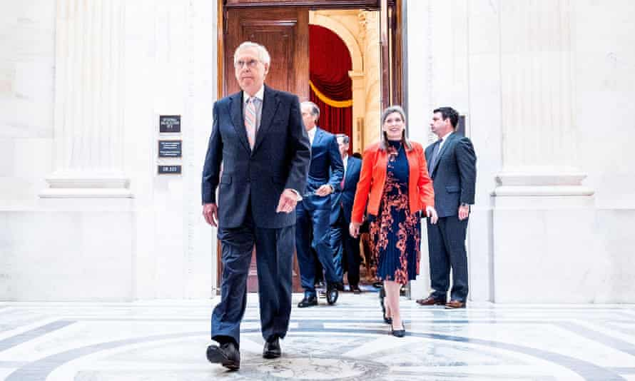 Mitch McConnell and Joni Ernst in Washington. McConnell, who previously condemned Trump's role in the riot, reportedly asked senators to nix the commission as a 'personal favour'.