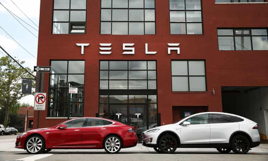 Two Tesla vehicles parked outside the company's headquarters.