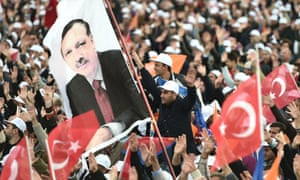 Supporters wave a flag at an AKP election rally.