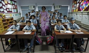 Teacher Archana Shori and seventh grade students at Rukmini Devi public school