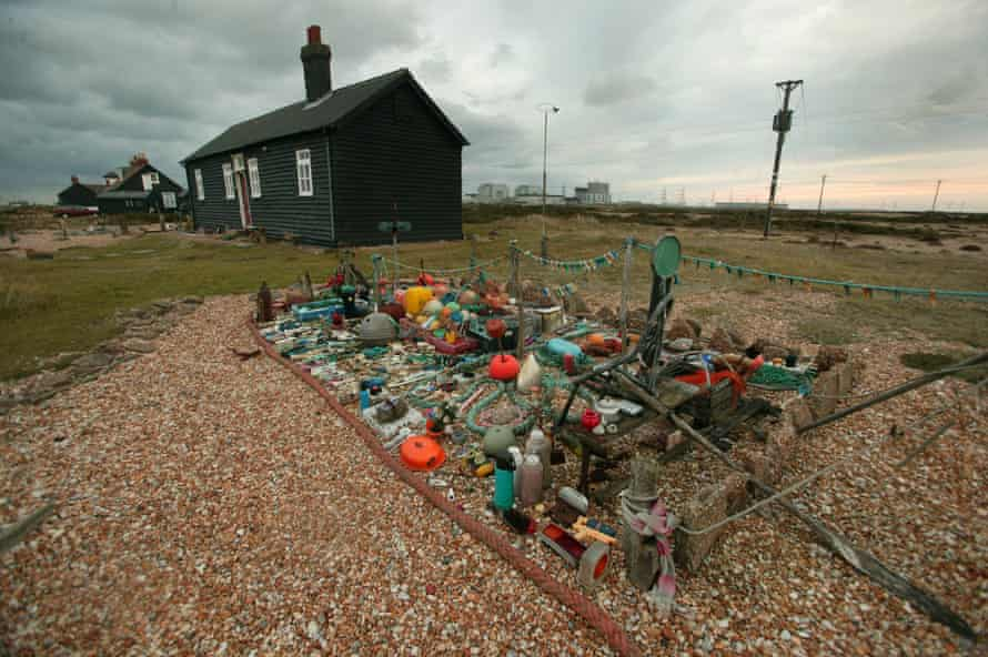 A cabin at Dungeness, its garden decorated with found objects.