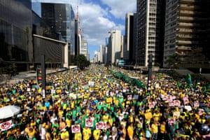 Demonstrators march at Paulista Avenue in Sao Paulo's financial centre.