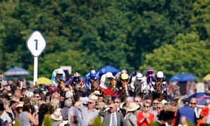 Frankie Dettori riding Stradivarius (yellow cap) on their way to winning the Gold Cup.