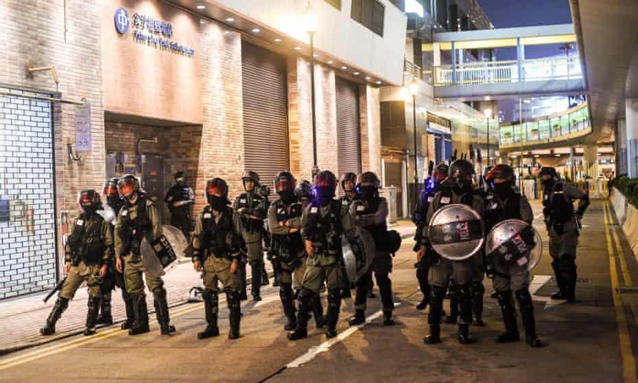 Police stand guard near Hong Kong Polytechnic in November 2019