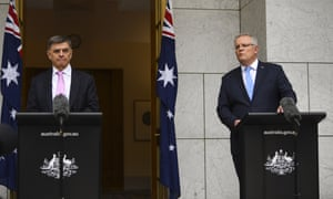Australia's Chief Medical Officer Brendan Murphy (L) and prime minister, Scott Morrison, hold a press conference at Parliament House in Canberra.