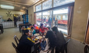 An Indian family eating at the canteen at Shimla railway station, India