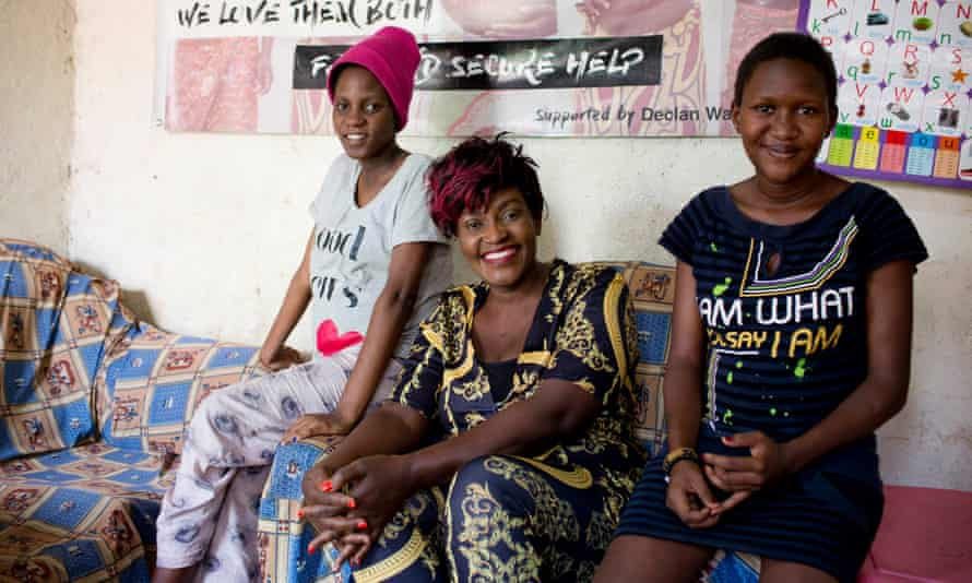 Cecila Ayoti, centre, with two teenage mothers she supports at a shelter in Kibera. Lorraine (left) and Vanessa are both pregnant with their first babies and have nowhere else to go because their families have disowned them