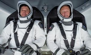 Nasa astronauts Bob Behnken (L) and Doug Hurley participating in a fully integrated test of SpaceX Crew Dragon flight hardware at Cape Canaveral