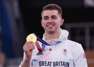 Gold medallist Max Whitlock of Britain celebrates on the podium with his medal.