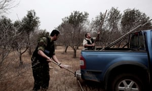 A British army policemen dismantles a trap used by poachers to catch migratory birds on a British base in southern Cyprus. An MP has sparked anger after posting a picture of himself at a table serving a dish of songbirds.