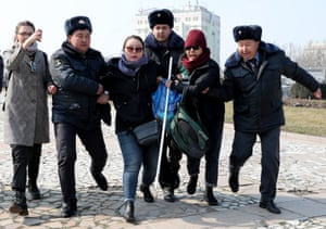 Police detain activists of the FEMEN women's movement on Victory Square, Bishkek, Kyrgyzstan