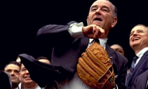 President Lyndon B Johnson wearing a baseball mitt