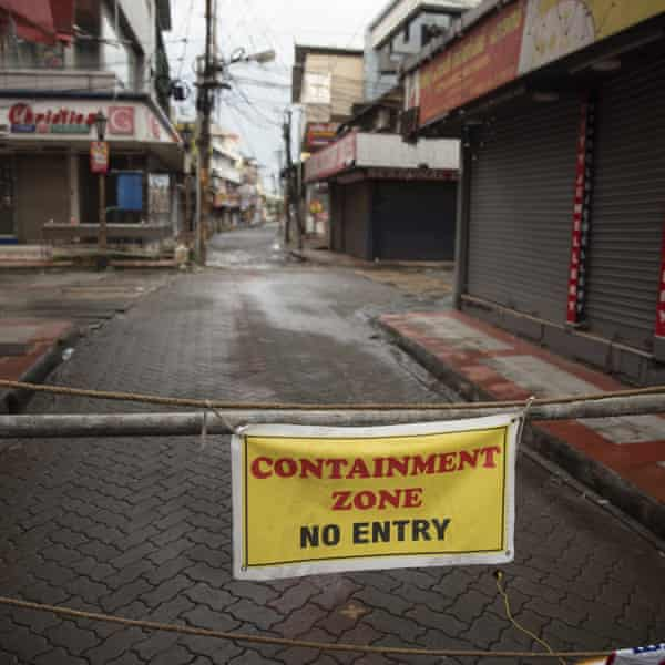 A generally busy market area of Kochi is sealed off