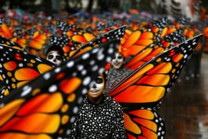 Participants dressed as Monarch butterflies perform during the annual Day of the Dead parade in Mexico City.