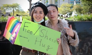 Pearl Jain and Lance Xie offer free hugs at Taipei Pride.