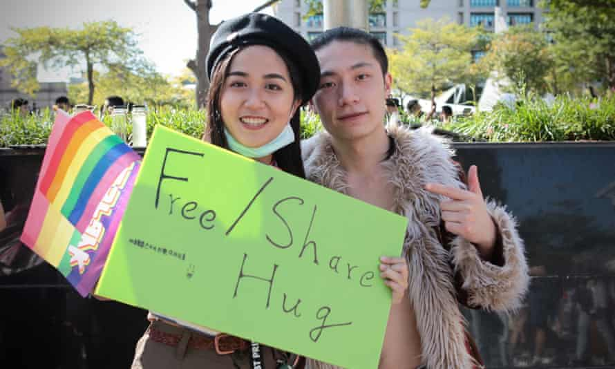 Pearl Jain and Lance Xie offer free hugs at Taipei Pride.