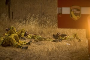 Santa Clara firefighters rest after fighting the Valley fire in Middletown