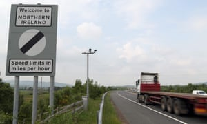 Traffic passes a border sign at Newry the the border of Northern Ireland.