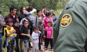 A group of migrant families are intercepted by Border Patrol near McAllen in Texas.