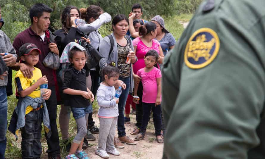 A group of migrant families are intercepted by US Border Patrol near McAllen, Texas on 19 June.