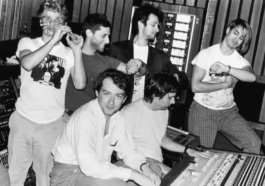 Andy Gill in the studio working on the Red Hot Chili Peppers' first album. Flea stands behind him, left.