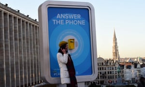 A woman answers a phone in Brussels