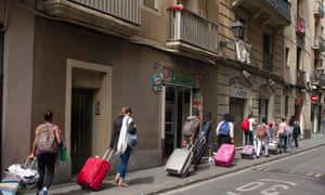 Tourists with wheelie bags in Barcelona