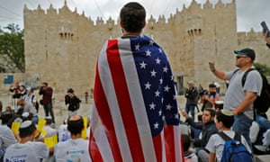 An Israeli man draped in the stars and stripes at Damascus gate in Jerusalem on Sunday