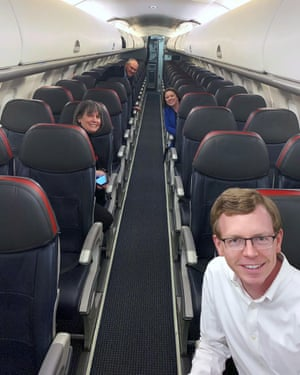 In this photo provided by Represenative Dusty Johnson, Johnson takes a selfie with House colleagues on a mostly empty plane on 27 March.