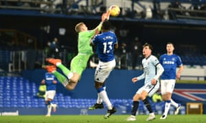 Everton keeper Jordan Pickford collides with Yerry Mina as he comes to catch the ball.