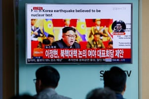South Koreans watch a North Korean TV report on Friday.