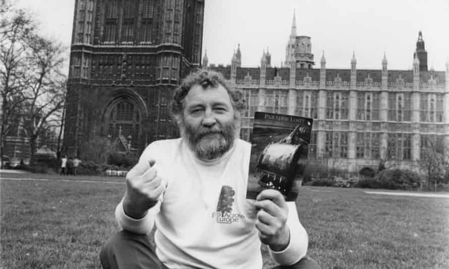 David Bellamy sitting in Parliament Square in 1981 with a copy of Paradise Lost?, the Friends of the Earth report on the widespread destruction of British wildlife.