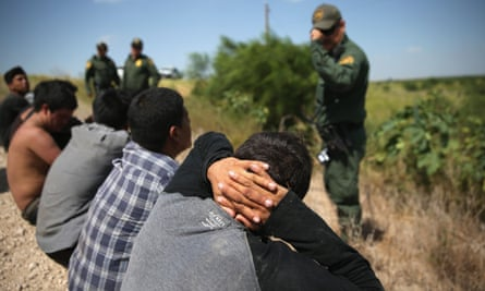 US border patrol agents detain undocumented immigrants after they crossed the border from Mexico into the United States in August in McAllen, Texas.
