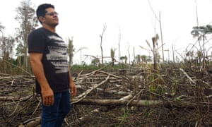 A Rondônia state environmental protection officer Nei Peres looks over a deforested section of land in Jaci Paraná reserve.