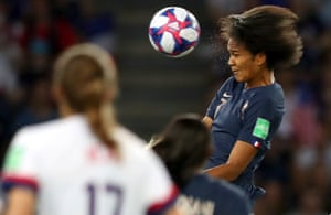 Wendie Renard of France scores her team's first goal during quarter final match between France and USA at Parc des Princes.