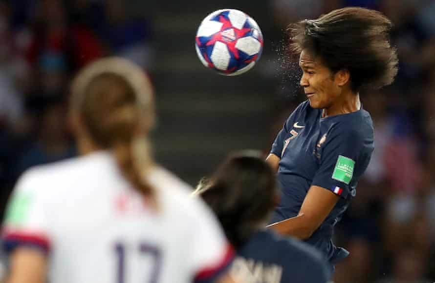 Wendie Renard of France scores her team's first goal during quarter final match between France and USA at Parc des Princes.