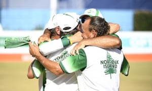Hadyn Evans and Ryan Dixon of Norfolk Island celebrate after winning the Bronze medal in the Mens Lawn Bowls Triples match against Canada.