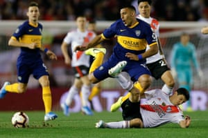 River Plate's Ignacio Fernández, right, tackles Ramón Ábila during the first leg of this year's semi-final, which River won 2-0.
