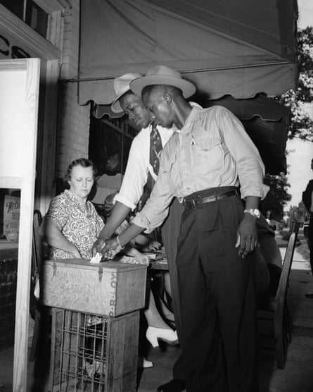 In Mississippi, two African American men vote for the first time in the 1946 Democratic primary. Many southern states have persisted with Jim Crow-era laws the disproportionately impact black voters.