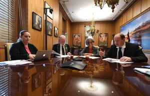 Governor Jared Polis, right, talks to legislators and staff about his initiative on full-day kindergarten in his office.
