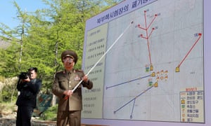 A North Korean soldier explains the demolition process of the Punggye-ri nuclear test facility.